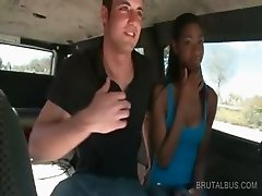Cute ebony giving blowjob in the bus