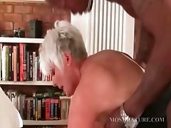 Stockinged mature fucks black hard cock