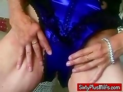 See this dirty blonde granny getting warmed up by finger fucking her old snatch