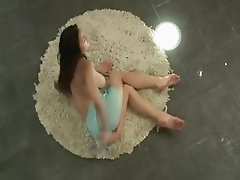 brunett babe teasing on circular carpet