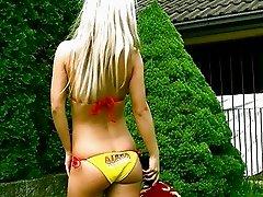 Skinny blonde in bikini reveals her shaved nookie outdoor