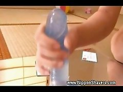 Asian silky pusys lips using dildo