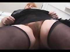 Busty hairy granny in stockings panty and upskirt tease showing off nice plump hairy pussy