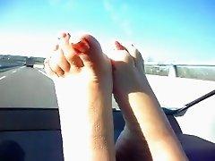 delicios feet in car trip