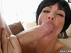 Short haired brunette sucks huge meaty cum shooter