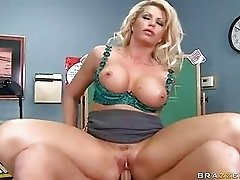 Busty tattooed blonde teacher gets slammed in office