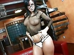 Busty brunette in tight fishnet lingerie fucks on red couch