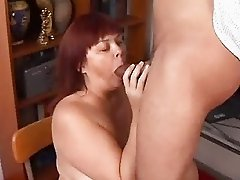 busty plumper gives a blowjob