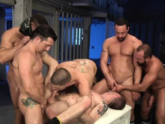 Troy is surrounded by a pack of studs who take turns fucking