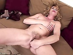 Curly hair mature babe fingers her cunt and fondles titties
