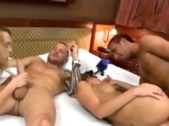 Two horny women shared a throbbing hard cock on the bed