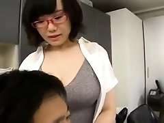 Luscious Oriental milf with big hooters loves young meat