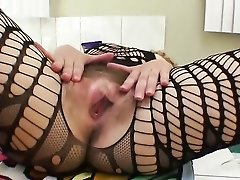 Mom models her body stocking and her huge bush
