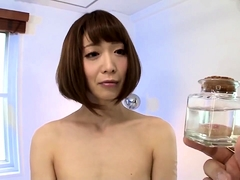 Sexy slim Asian shemale has a guy drilling her fiery ass