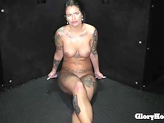 sexy stripper makes money giving head in a gloryhole