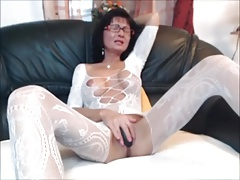 Sexy brunette MILF in body stocking plays with herself