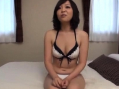 Oriental gal gets wet as she plays with her love tunnel
