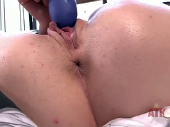 Cute brunette toys her smooth love button in close up
