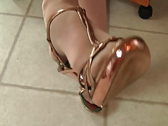 Pantyhose feet in metallic heels preview