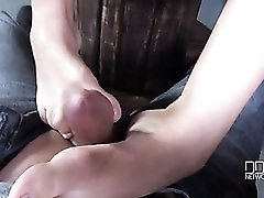 Sexy chick in a corset gives a POV footjob