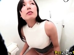 Big-Chested Asian stunner pisses