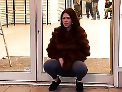 Public cameltoe and pissing show from a girl in fur