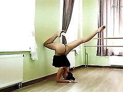 Flexible ballerina stretching in the nude