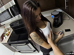 Tattooed brunette beauty kneels to suck a stiff prick in a POV blowjob session