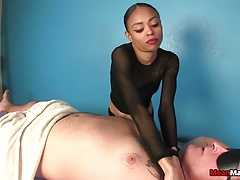 Black masseuse teasing guys cock