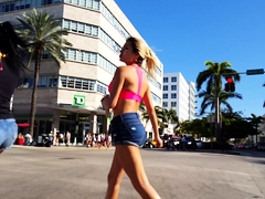 Street voyeur follows a gorgeous blonde babe in tight shorts