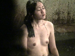 Charming Asian girl with nice titties enjoys a relaxing bath