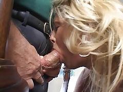 Hot blonde deep throats a hard cock with her old husband in the room
