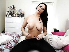 Tight wet look leggings on a femdom babe