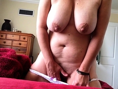 Horny mature lady with big natural boobs fingers her peach
