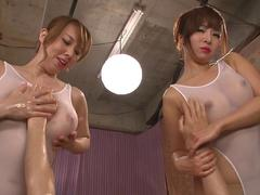 Brunette Asian with big boobies get oiled up during a sexy massage