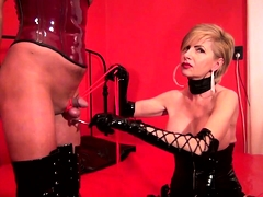 Busty blonde dominatrix in black latex punishes a meat pole