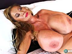 Mature babe Minka shows her enormous tits and masturbates