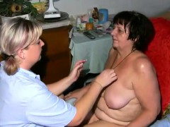 Two ladies getting oiled up and ready