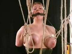 Busty slave's big boobs tightly bound and massaged by master