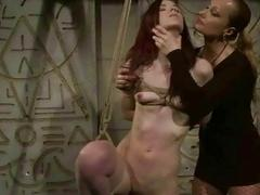 Mistress dominating sexy redhead bondage slave in the dungeon BDSM