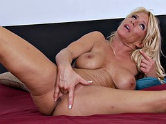 Blonde MILF plays with her juicy pussy and her ass