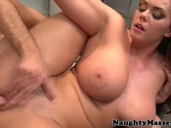 Busty oiled babe pussylicked by masseuse