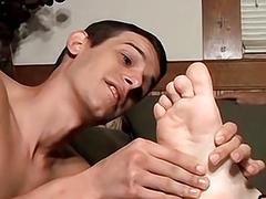 Perverted twink jacking lovers cock off with hand and feet