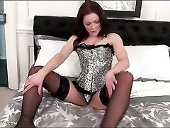 Tight corset is stunningly sexy on a milf