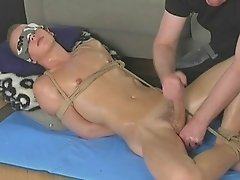 Tied up twink getting his dick stroked